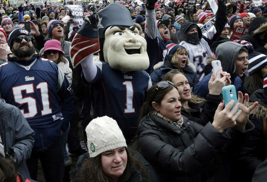 New England Patriots mascot Pat Patriot, center, and fans fans cheer during an NFL football send-off rally at City Hall in Boston Monday, Jan. 26, 2015. The Patriots play the Seattle Seahawks in Sunday's Super Bowl XLIX in Glendale, Ariz. (AP Photo/Charles Krupa)