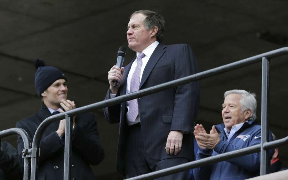 New England Patriots head coach Bill Belichick, center, addresses a crowd of supporters during an NFL football send-off rally at City Hall in Boston Monday, Jan. 26, 2015. The Patriots play the Seattle Seahawks in Sunday's Super Bowl XLIX in Glendale, Ariz. At left is Patriots quarterback Tom Brady, at right is Patriots owner Robert Kraft. (AP Photo/Charles Krupa)
