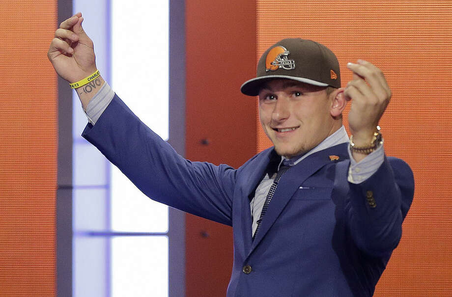 FILE - In this May 8, 2014, file photo, Texas A&M quarterback Johnny Manziel reacts after being selected by the Cleveland Browns as the 22nd pick during the first round of the NFL Draft in New York. The Browns indicated Tuesday, Feb. 2, 2016, that they've finally had enough of Manziel's bad-boy behavior and intend to release the quarterback in March when the league begins its next calendar year. (AP Photo/Frank Franklin II, File)