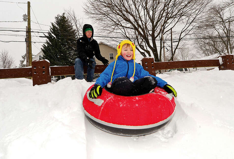 Hour photo / Erik Trautmann Rikki Lawrence and her son, Connor, 7, go sledding at Fitch Park on Starwberry Ave as Norwalkers cope with the blizzard that hit the Northeast Tuesday.