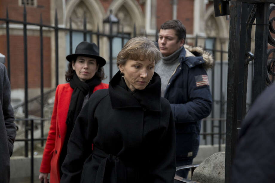 "Marina Litvinenko, center, the widow of former Russian intelligence officer Alexander Litvinenko, leaves for the lunch break in proceedings at the Royal Courts of Justice in London, Tuesday, Jan. 27, 2015. A British judge opened an inquiry Tuesday into the death of Alexander Litvinenko, declaring the issues raised in the poisoning death of the former Russian intelligence agent to be of the ""utmost gravity."" Litvinenko, who had become a Britain-based critic of the Kremlin, became violently ill in November 2006 after drinking tea with two Russian men at a London hotel. He died three weeks later. (AP Photo/Matt Dunham)"