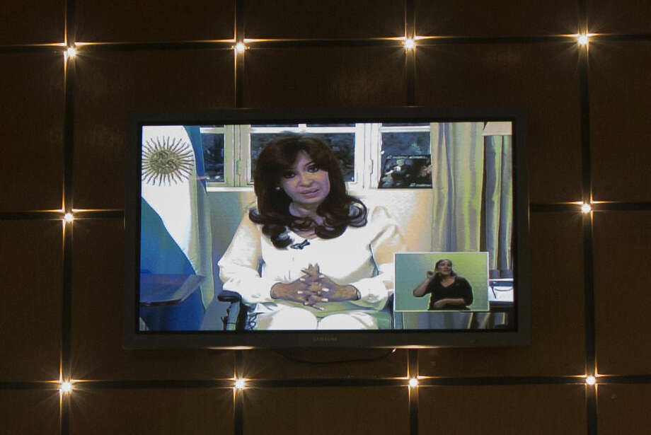 A TV screen in a restaurant shows a live speech by Argentina's President Cristina Fernandez during her first public comments since the mysterious death of special prosecutor Alberto Nisman, in Buenos Aires, Argentina, Monday, Jan. 26, 2015. Nisman was found dead Jan. 18 in his apartment, the day before he was scheduled to elaborate on explosive allegations that Fernandez shielded Iranian officials suspected in the largest terrorist attack in the South American country's history. (AP Photo/Ivan Fernandez)