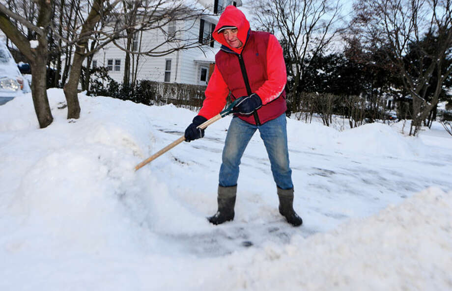 Peter Pytel shovels his walk of Adams Street following the snowstorm Tuesday that dumped several inches in the area.