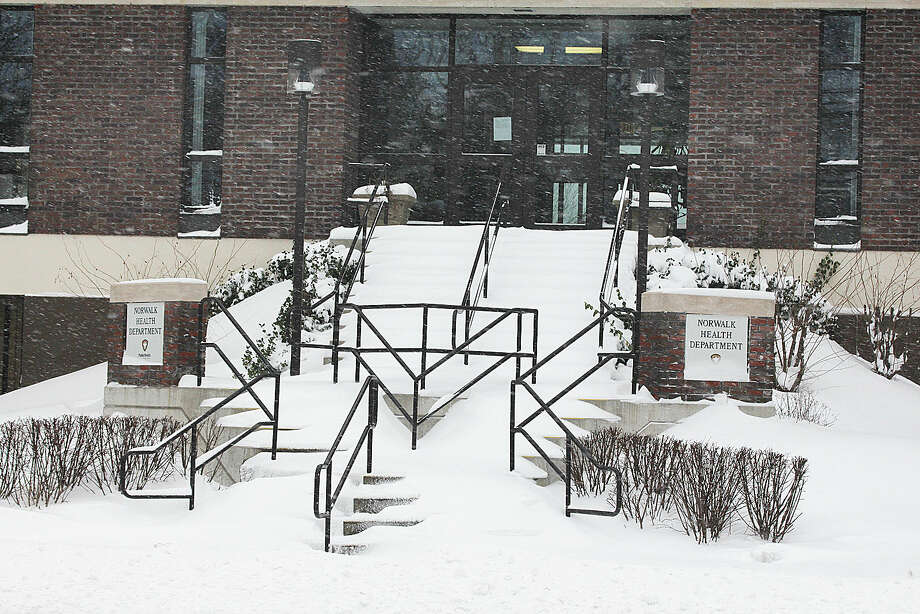 Hour photo/Chris Bosak The steps at the East Avenue entrance to the Norwalk Health Department are covered with snow Tuesday morning.