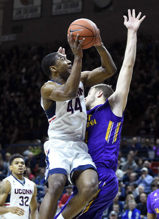 Connecticut's Rodney Purvis (44) drives past East Carolina's Michael Zangari (34) during the first half of an NCAA college basketball game in Storrs, Conn., on Sunday, Feb. 7, 2016. (AP Photo/Fred Beckham)