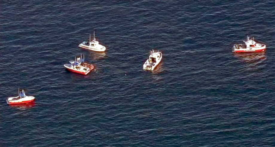 In this still frame from video provided by KABC-TV, a flotilla of boats search for wreckage from two small planes that collided in midair and plunged into the ocean off of Los Angeles harbor Friday, Feb. 5, 2016. There was no immediate word of any survivors, authorities said. The planes collided at around 3:30 p.m. and apparently went into the water about two miles outside the harbor entrance, U.S. Coast Guard and other officials said.(KABC-TV via AP) MANDATORY CREDIT TV OUT