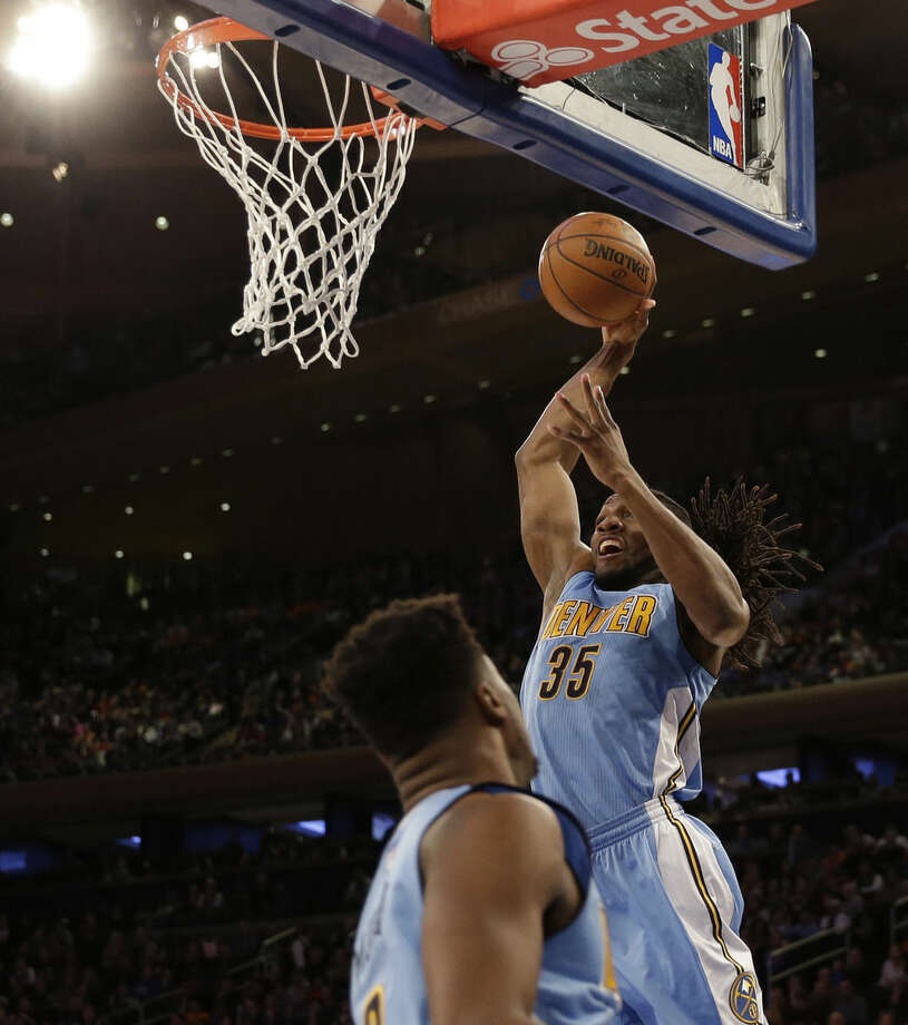 Denver Nuggets' Kenneth Faried, right, goes up to dunk during the first half of an NBA basketball game against the New York Knicks, Sunday, Feb. 7, 2016, in New York. (AP Photo/Seth Wenig)
