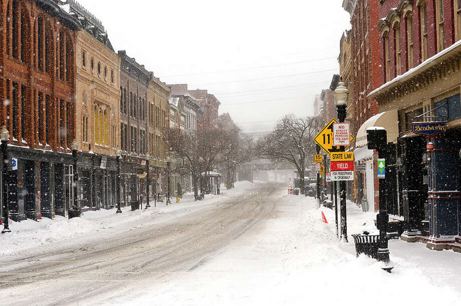 Hour photo / Erik Trautmann Washington St is deserted as Norwalkers cope with the blizzard that hit the Northeast Tuesday.