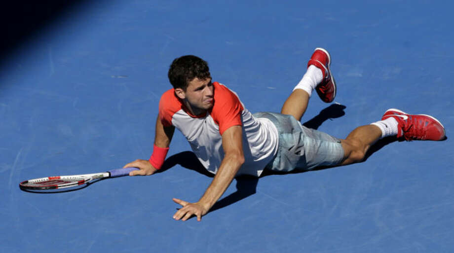 Grigor Dimitrov of Bulgaria lies on the court between points as he plays Rafael Nadal of Spain during their quarterfinal at the Australian Open tennis championship in Melbourne, Australia, Wednesday, Jan. 22, 2014. (AP Photo/Aijaz Rahi)