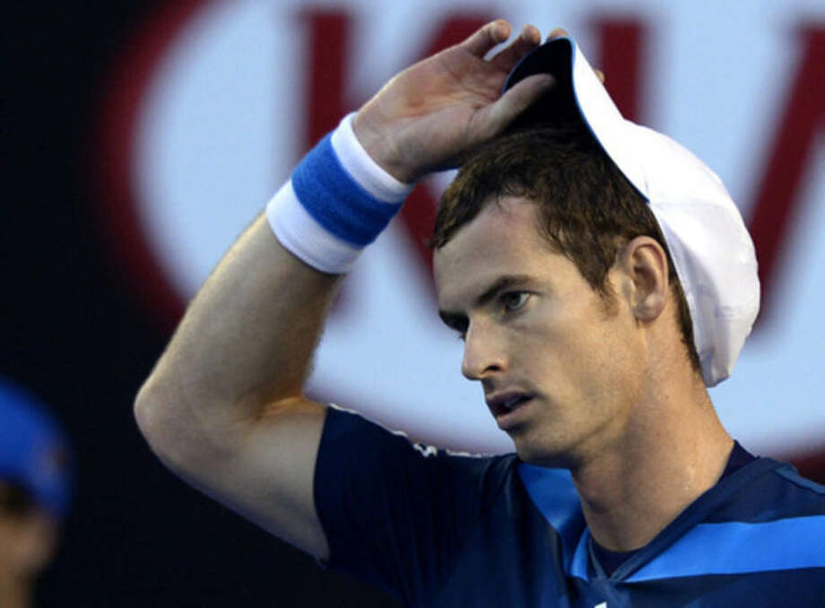 Andy Murray of Britain adjusts his cap as he plays Roger Federer of Switzerland during their quarterfinal at the Australian Open tennis championship in Melbourne, Australia, Wednesday, Jan. 22, 2014.(AP Photo/Andrew Brownbill)
