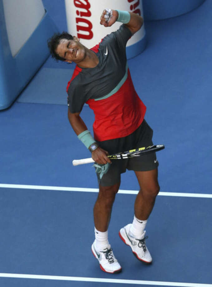Rafael Nadal of Spain celebrates after defeating Grigor Dimitrov of Bulgaria during their quarterfinal at the Australian Open tennis championship in Melbourne, Australia, Wednesday, Jan. 22, 2014.(AP Photo/Eugene Hoshiko)