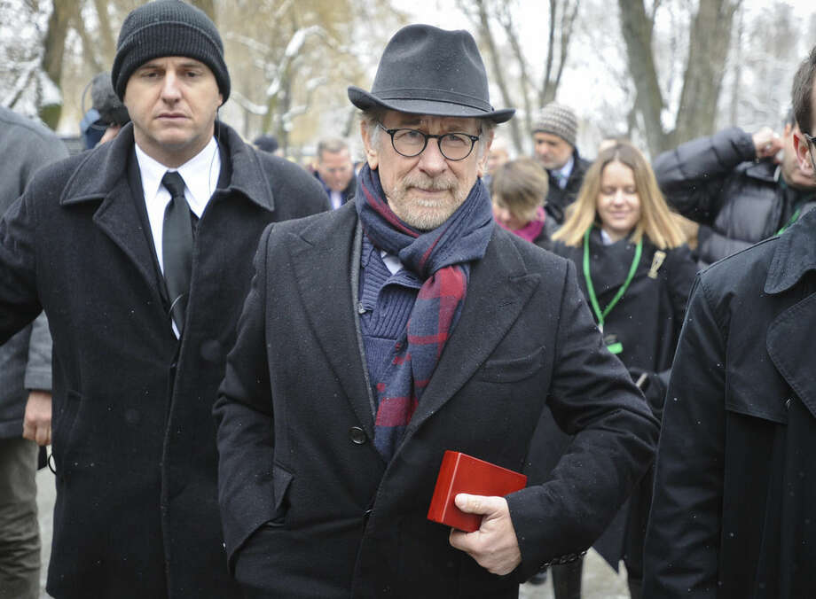 US film director Steven Spielberg leaves after attending the unveiling of a memorial plaque at the Auschwitz Nazi death camp in Oswiecim, Poland, Tuesday, Jan. 27, 2015. Some 300 Holocaust survivors traveled to Auschwitz for the 70th anniversary of the death camp's liberation by the Soviet Red Army in 1945, down from 1,500 who attended the event 10 years ago.(AP Photo/Alik Keplicz)