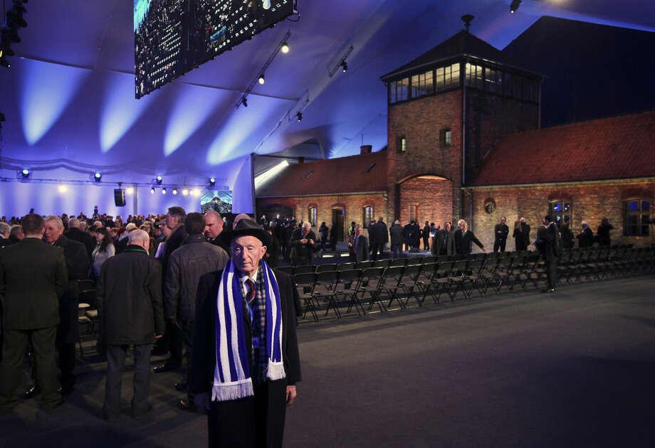 Holocaust survivor Jehuda Widawski, walks in the tent at the entrance of the Birkenau Nazi death camp in Oswiecim, Poland, Tuesday, Jan. 27, 2015, before the start of the official remembrance ceremony. About 300 survivors will gather with leaders from around the world Tuesday to remember the 1.1 million people killed at Auschwitz-Birkenau and the millions of others killed in the Holocaust.(AP Photo//Czarek Sokolowski)