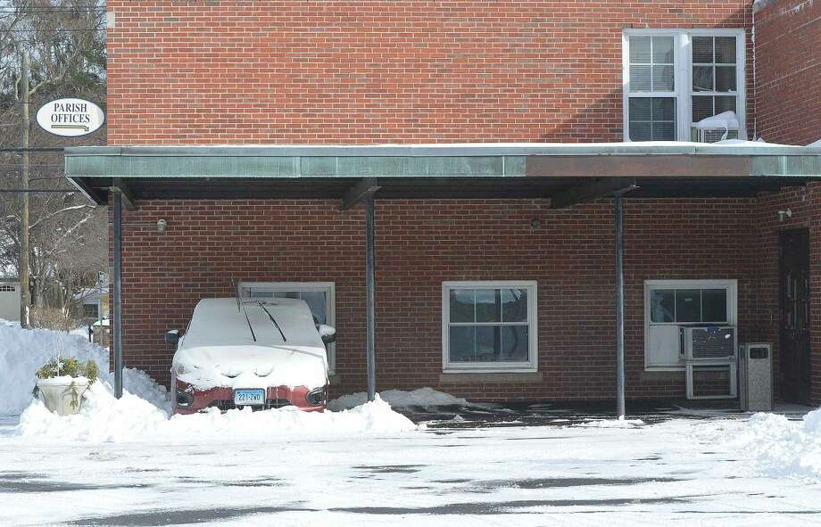 Hour Photo/Alex von Kleydorff The owner of this car had the right idea, parking under an overhang at St. Philip RC Church, but blowing snow was able to find its way under.