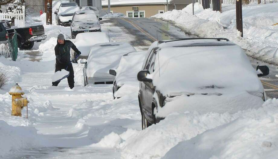 Hour Photo/Alex von Kleydorff People dig out in their neighborhoods on Tuesday