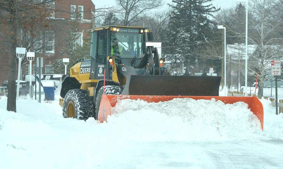 Hour Photo/Alex von Kleydorff The heavy snow removal equipment is working to clear the area at City Hall in Norwalk Tuesday