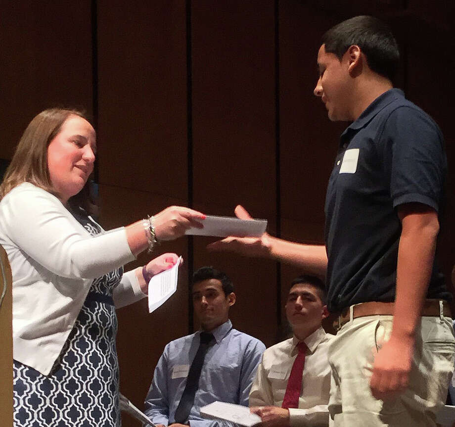 Steven Mariscal receives his award for the Silver Shield Law Enforcement Scholarship from Greenwich High School guidance counselor Jennifer Lynch, at the 44th annual Greenwich Scholarship Association awards ceremony held Thursday, June 9, 2016 at Greenwich High School. Photo: Paul Schott