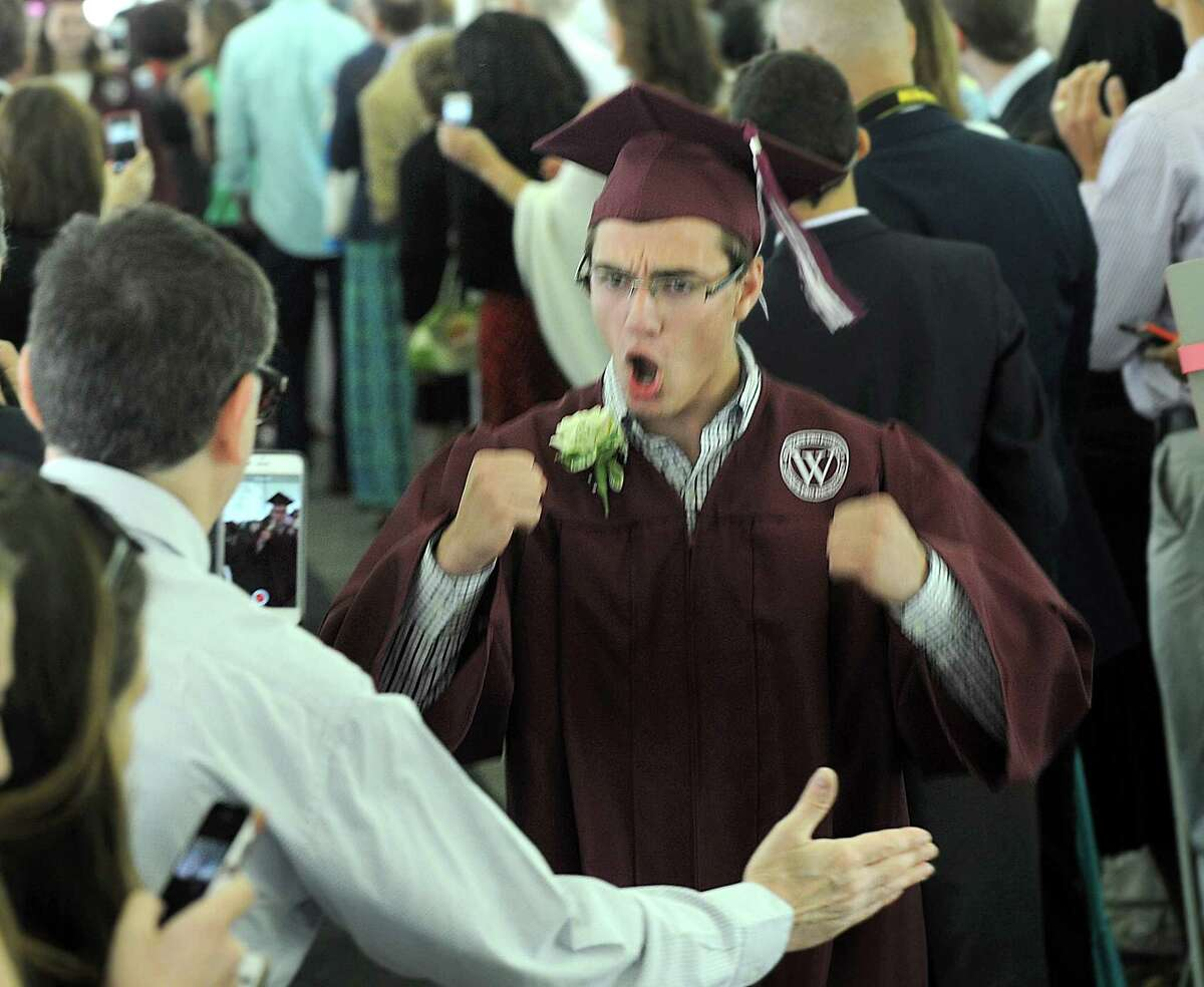 Max Levine gestures during the processional at the start of graduation, Friday., June 10, 2016. Wooster School in Danbury, Conn., holds its commencement ceremony for the graduating class of 2016, Friday, June 10, 2016.