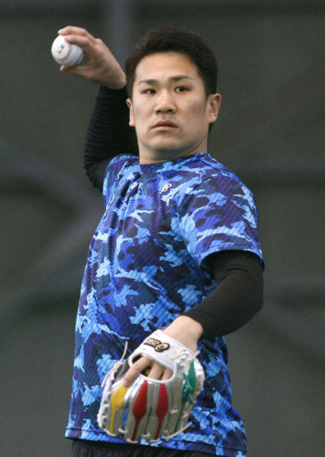 Japanese pitcher Masahiro Tanaka throws a ball during the morning workout at the Rakuten Golden Eagles' indoor training facility in Sendai, northeastern Japan, Thursday, Jan. 23, 2014. The New York Yankees capped an offseason spending spree by agreeing Wednesday, Jan. 22 to a $155 million, seven-year contract with prized 25-year-old right-hander Tanaka. (AP Photo/Kyodo News) JAPAN OUT, CREDIT MANDATORY