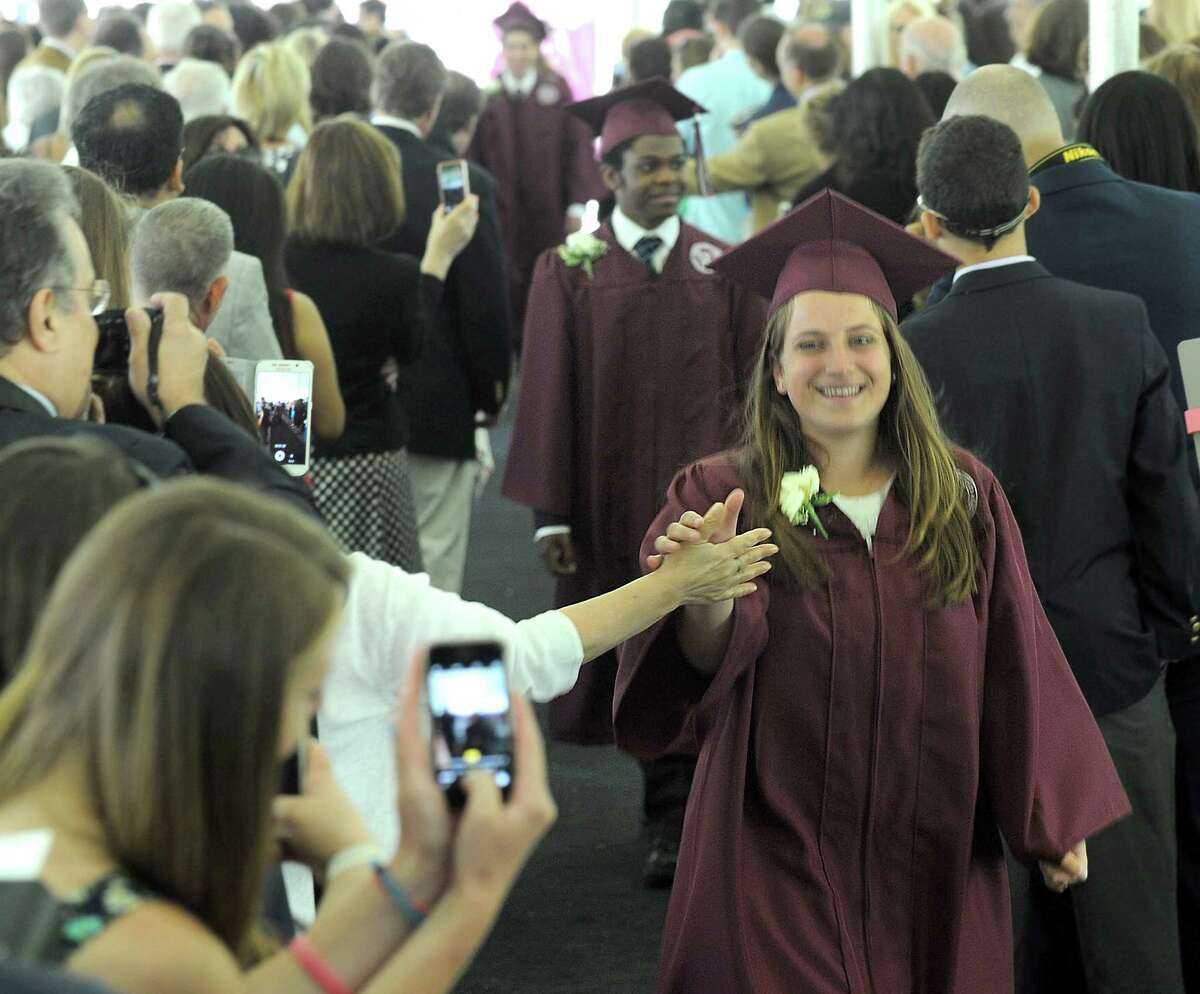 Anna Krzyzewski in front, Trevor Jones in back, during the processional into Friday morning's commencement ceremony at Wooster School in Danbury, Friday, June 10, 2016.