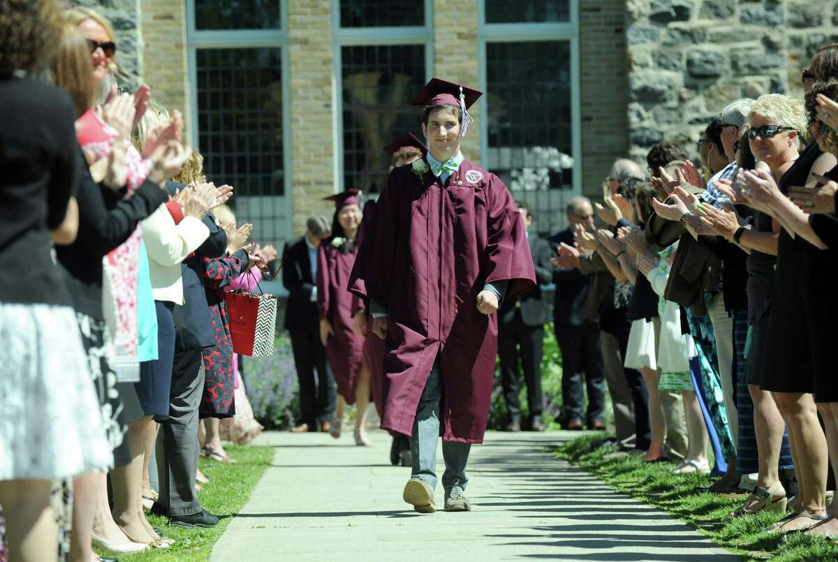 Aaron Young walks in the processional at the start of Wooster School's commencement ceremony for the graduating class of 2016, Friday, June 10, 2016.