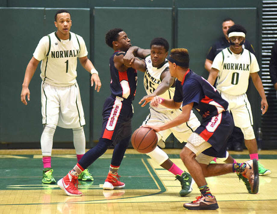 Hour photo/John Nash - The Brien McMahon boys basketball team defeated Norwalk 82-70 in an intra-city showdown on Saturday at Scarso Gym in Norwalk.