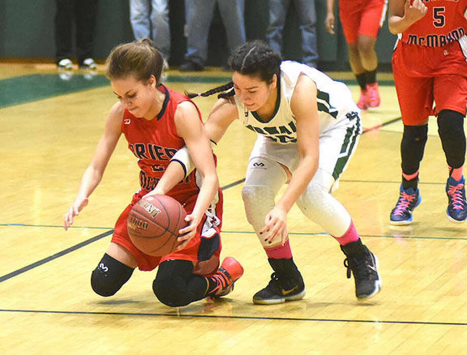 Hour photo/John Nash - Action photos from Saturday's Norwalk vs. Brien McMahon girls basketball game at Scarso Gym in Norwalk. The Bears topped the Senators 65-25.