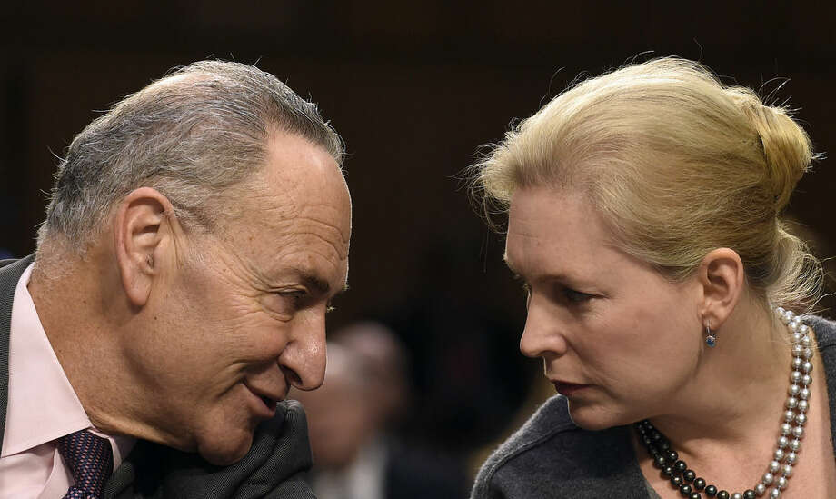 Sen. Charles Schumer, D-N.Y., left, talks with Sen. Kirsten Gillibrand, D-N.Y., on Capitol Hill in Washington, Wednesday, Jan. 28, 2015, where they introduced Attorney General nominee Loretta Lynch before the Senate Judiciary Committee's hearing on Lynch's nomination. If confirmed, Lynch would replace Attorney General Eric Holder, who announced his resignation in September after leading the Justice Department for six years. The 55-year-old federal prosecutor would be the nation's first black female attorney general. (AP Photo/Susan Walsh)