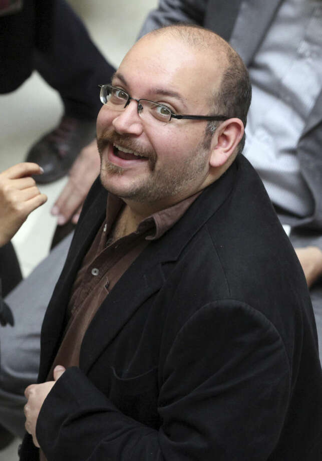 "FILE - In this photo April 11, 2013 file photo, Jason Rezaian, an Iranian-American correspondent for the Washington Post, smiles as he attends a presidential campaign of President Hassan Rouhani in Tehran, Iran. The journalist detained in Iran for months will stand trial ""soon,"" the Islamic Republic's official news agency reported Wednesday, Jan. 28, 2015. The report by the IRNA news agency quoted Gholam Hossein Esmaeili, a senior judicial official. The report did not offer a specific time for the trial to start.(AP Photo/Vahid Salemi, File)"