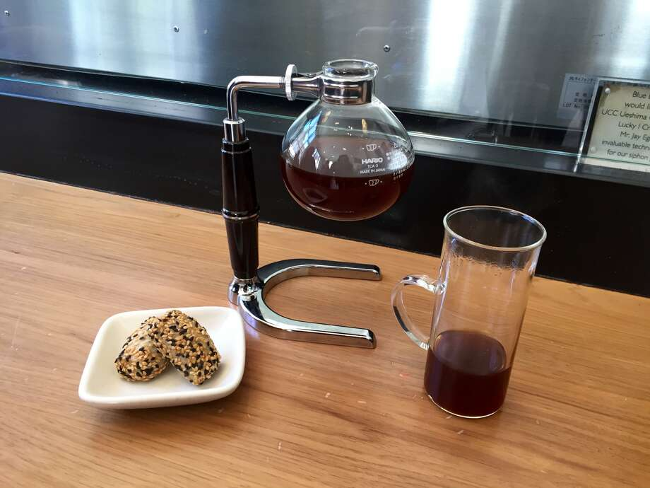 Josh Smith prepares a $16 Port of Mokha Coffee at Blue Bottle in SoMa on June 10, 2016.