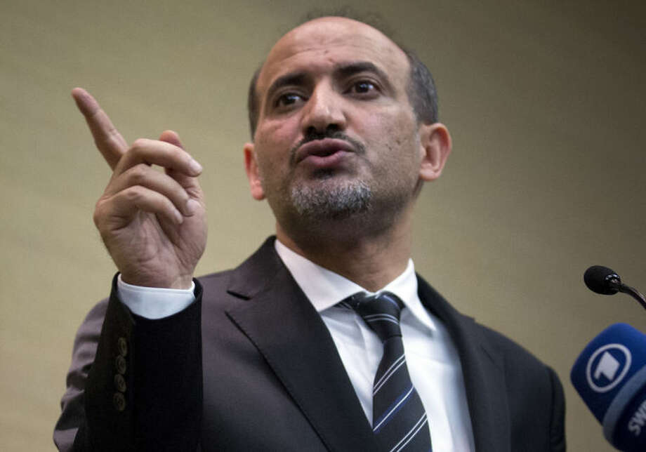 Ahmad al-Jarba, leader of the Syrian National Coalition (SNC), Syria's main political opposition group, points his finger during a press conference in Geneva, Switzerland, Thursday, Jan. 23, 2014. Al-Jarba announced that the Syrian peace talk negotiations will be difficult and that Syrian President Bashar al-Assad is now part of the past. (AP Photo/Anja Niedringhaus)