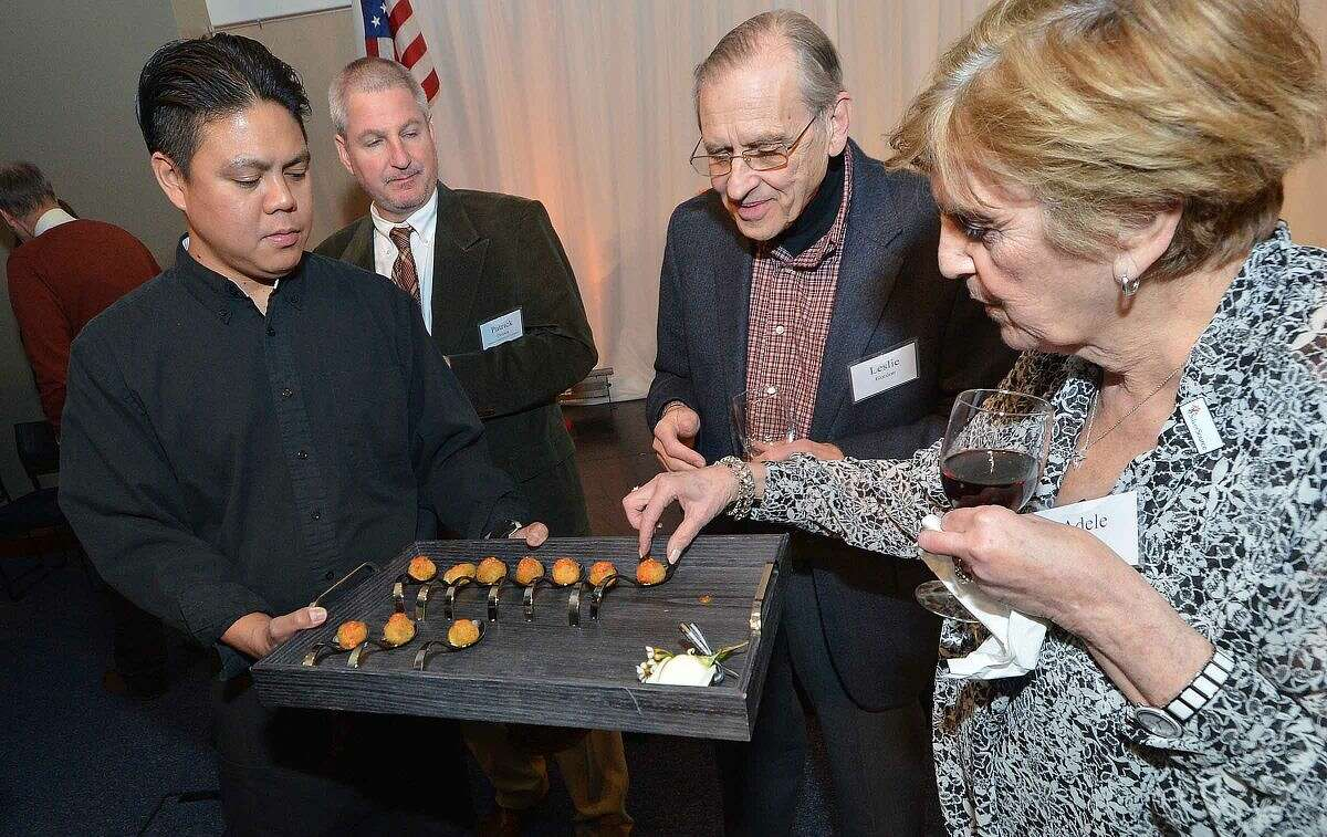 Guests enjoy some of the appetizers during a reception for SilverSource.