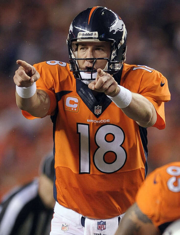 """FILE - In this Sept. 23, 2013, file photo, Denver Broncos quarterback Peyton Manning (18) calls an audible at the line of scrimmage in the third quarter of an NFL football game against the Oakland Raiders in Denver. The sound of Manning barking """"Omaha! Omaha!"""" is picked up by a tiny microphone in an offensive lineman's pads so it can be broadcast to the world. In an age of enormous high-definition televisions and games streamed to tablets and smartphones, audio seems almost quaint. Yet TV executives have made it a major focus in recent years, for the exact reason so many people are fascinated by the Broncos quarterback's audibles. (AP Photo/Jack Dempsey, File)"""