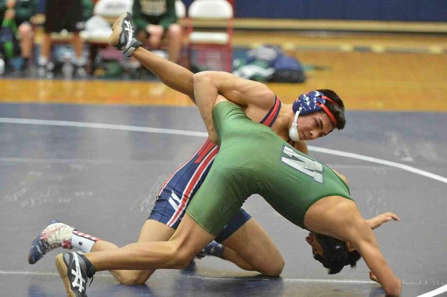 Hour Photo/Alex von Kleydorff McMahons Jason martinez wins in the 138lb class