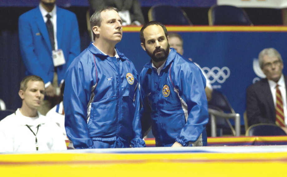 "AP photoThis image released by Sony Pictures Classics shows Steve Carell, left, and Mark Ruffalo in a scene from ""Foxcatcher."""