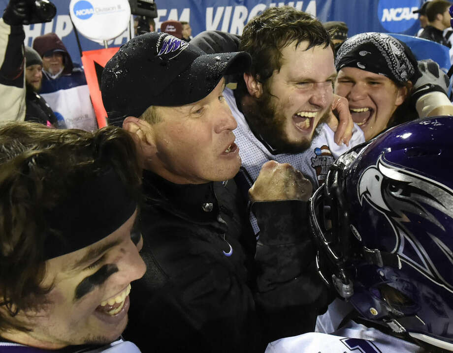 FILE - In this Dec. 19, 2014 file photo, Wisconsin-Whitewater head coach Lance Leipold, center, and his players celebrate Whitewater defeating Mount Union in the NCAA Division III championship college football game in Salem, Va. It's not often that a football dynasty undergoes a transition in the middle of a championship run. But Wisconsin-Whitewater is looking for a new coach after winning four of the last five national titles. (AP Photo/Don Petersen, File)