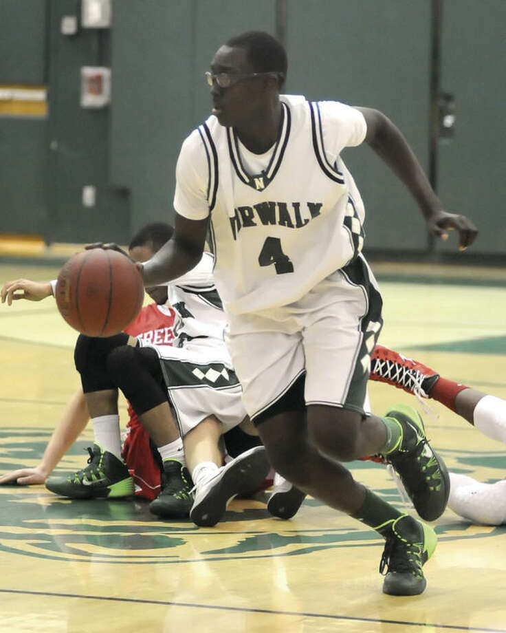 Hour photo/John NashNorwalk's Roy Kane Jr. (4) races away from a pile of bodies after picking up a loose ball during the third quarter of Thursday's game at Scarso Gym.