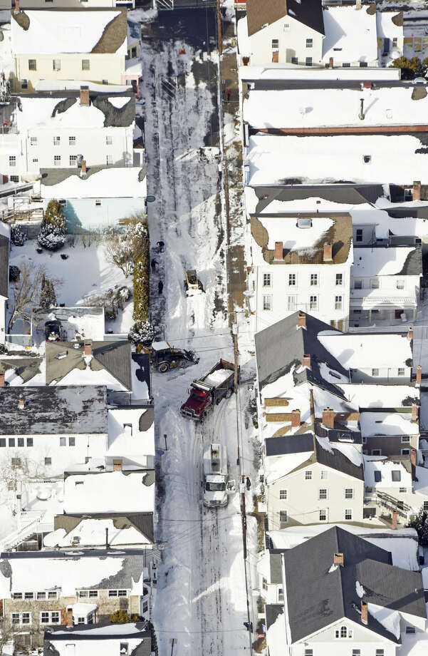 In this aerial photo crews clear snow in Stonington, Conn., Wednesday, Jan. 28, 2015. (AP Photo/The Day, Sean D. Elliot) MANDATORY CREDIT