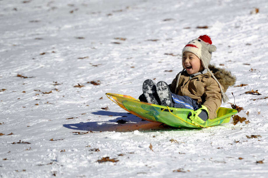 Carl Jeon, 4, sleds at Van Saun Park in Paramus, N.J., Wednesday, Jan. 28, 2015. (AP Photo/Northjersey.com, Amy Newman)