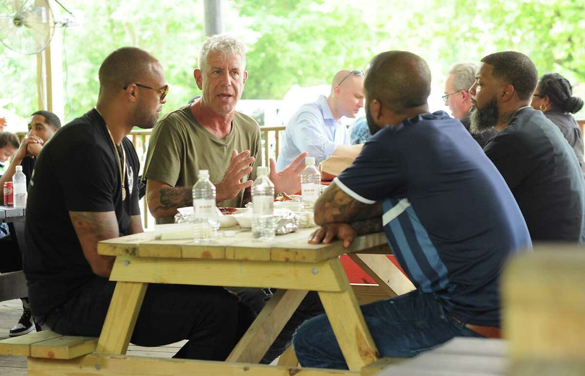 """Anthony Bourdain, host of the popular CNN food show """"Parts Unknown"""" is filmed at Burns Original BBQ Friday June 10, 2016. With Bourdain are Slim Thug, Red Bone and David Stunts."""