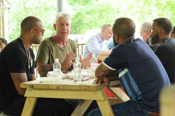 Anthony Bourdain, host of the popular CNN food show, Parts Unknown, is filmed at Burns Orginal Barbecue Friday June 10,2016. With Bourdain are Slim Thug, Red Bone and David Stunts.(Dave Rossman Photo)