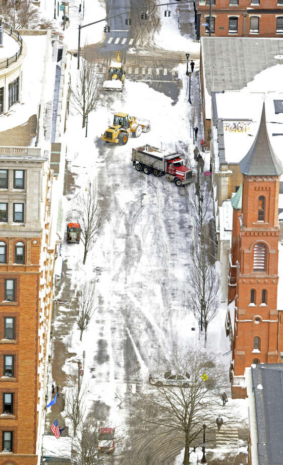 This aerial photo shows crews clear snow after a winter storm Wednesday, Jan. 28, 2015, in New London, Conn. (AP Photo/The Day, Sean D. Elliot) MANDATORY CREDIT