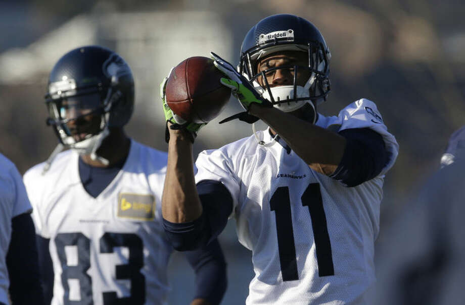 Seattle Seahawks wide receiver Percy Harvin (11) catches the football during warm-up drills before NFL football practice, Thursday, Jan. 23, 2014, in Renton, Wash. The Seahawks will play the Denver Broncos Feb. 2, 2014 in the Super Bowl. (AP Photo/Ted S. Warren)