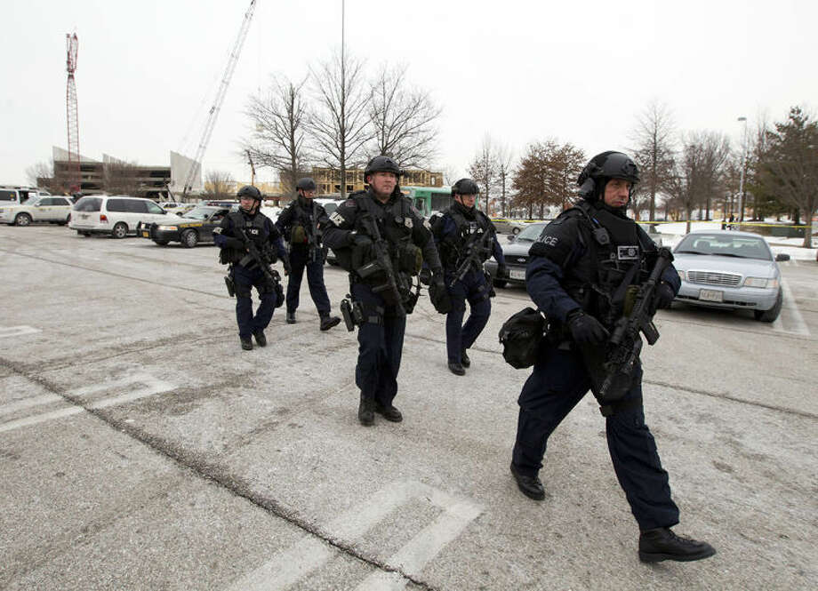 AP Photo / Jose Luis MaganaPolice move in from a parking lot to the Mall in Columbia after reports of a multiple shooting, Saturday Jan. 25, 2014 Howard County, Md. Police in Maryland say three people died Saturday in a shooting at a mall in suburban Baltimore, including the presumed gunman.