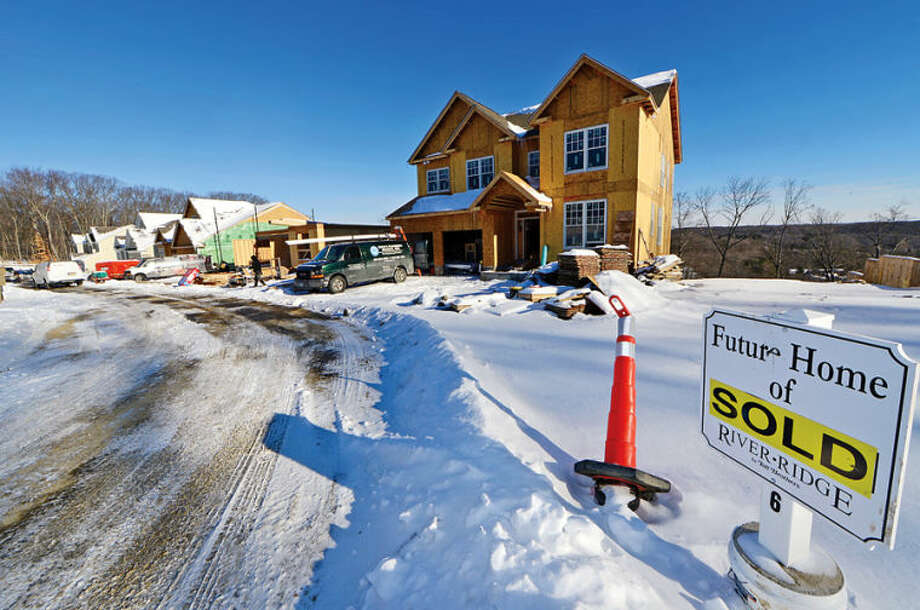 Sixteen of the 20 houses, priced around $800,000, in the luxury home development River Ridge have been sold.