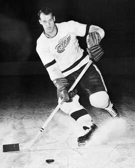 "FILE - This is a 1956 file photo showing Detroit Red Wings hockey player Gordie Howe. Gordie Howe, the hockey great who set scoring records that stood for decades, has died. He was 88. Son Murray Howe confirmed the death Friday, June 10, 2016, texting to The Associated Press: ""Mr Hockey left peacefully, beautifully, and w no regrets.""(AP Photo/File)"
