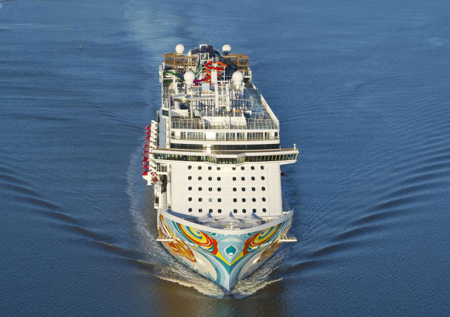 """This undated image provided by Norwegian Cruise Lines shows Norwegian Getaway, a ship debuting this month. It will homeport in Miami and its colorful exterior was designed by Miami-based Cuban-American artist David Le Batard, also known as """"LEBO."""" Getaway is a sister ship to Norwegian Breakaway, which debuted in 2013 with a New York theme and homeports from Manhattan. (AP Photo/ Norwegian Cruise Lines)"""