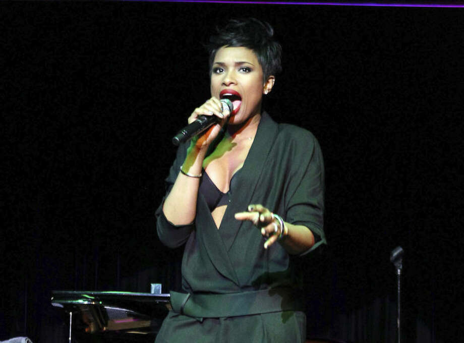 """This Jan 22, 2014 photo released by Starpix shows singer Jennifer Hudson performing at an event to launch """"Carnival LIVE,"""" a first-of-its kind on-board concert series by Carnival Cruise Lines in New York. Before she blasted to stardom on """"American Idol"""" and """"Dreamgirls,"""" Hudson sang on a cruise ship. And on Wednesday, the singer returned as the headliner for a new concert series on Carnival Cruise Lines called Carnival Live. Hudson is scheduled to perform June 18 on Carnival Ecstasy and June 19 on Carnival Breeze, both in Cozumel, Mexico. (AP Photo/Starpix, Kristina Bumphrey)"""
