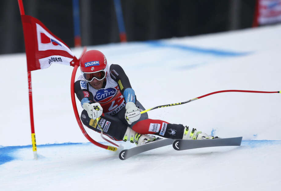 ADVANCE FOR WEEKEND EDITIONS, JAN. 25-26 - In this Dec, 20, 2013, file photo, Bode Miller, of the United States speeds down the hill on his way to take eight place in the men's World Cup super-G ski race in Val Gardena, Italy. Miller, a five-time Olympic medalist, was away from competition for 20 months, as he worked his way back from microfracture surgery on his left knee, which originally was injured all the way back in 2001. (AP Photo/Marco Trovati, File)