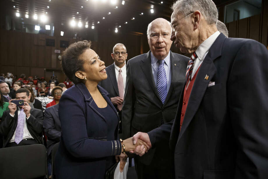 Senate Judiciary Committee Chairman Sen. Charles Grassley, R-Iowa, right, accompanied by the committee's ranking member, Sen. Patrick Leahy, D-Vt.,, center, greets Attorney general nominee Loretta Lynch on Capitol Hill in Washington, Wednesday, Jan. 28, 2015, prior to the start of her confirmation hearing before the committee. This is the first nomination hearing under the new Republican majority. (AP Photo/J. Scott Applewhite)